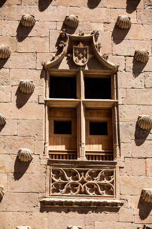 Detail of the windows of the historical House of the Shells built in 1517 by Rodrigo Arias de Maldonado knight of the Order of Santiago de Compostela in Salamanca, Spain