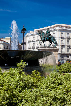 MADRID, SPAIN - MAY, 2018: Fountain and the equestrian statue of Carlos III located at Puerta del Sol in Madrid