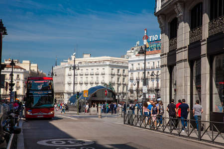 MADRID, SPAIN - MAY, 2018: View of the public transport at Plaza del Sol square including Sol Metro station and public bus Editorial