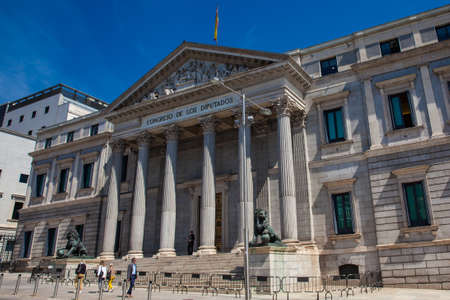MADRID, SPAIN - MAY, 2018:  Palacio de las Cortes building in Madrid house of  the Spanish Congress of Deputies located on the Calle Zorrilla and the Carrera de San Jeronimo built by Narciso Pascual Colomer from 1843 to 1850 in the neoclassic style