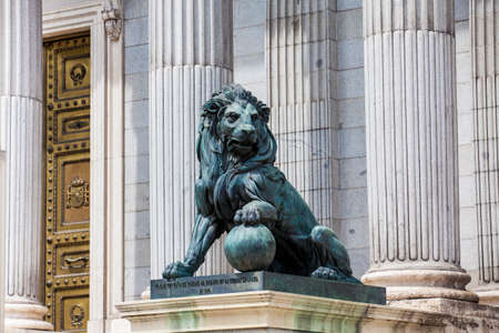 MADRID, SPAIN - MAY, 2018:  Lion statue at the Palacio de las Cortes building in Madrid house of  the Spanish Congress of Deputies built by Narciso Pascual Colomer from 1843 to 1850 in the neoclassic style Editorial