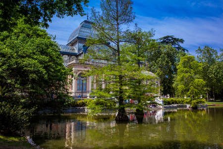 MADRID, SPAIN - MAY, 2018: View of the beautiful Palacio de Cristal a conservatory located in El Retiro Park built in 1887 in Madrid