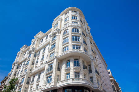 Beautiful architecture of the antique buildings located at Gran via street in Madrid