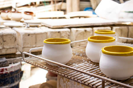 Clay injection molding technique in a traditional ceramics factory at the small city of Raquira in Colombia