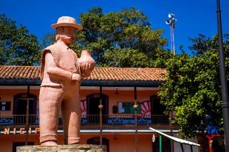 RAQUIRA, COLOMBIA - FEBRUARY 2021. Beautiful clay statues at Raquira city main square.The city of pots, Colombia Sajtókép