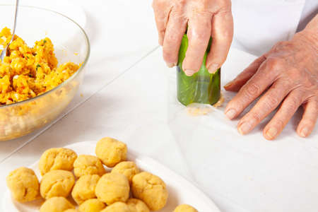 Preparation of the traditional patties from the region of Cauca in Colombia, called empanadas de pipián