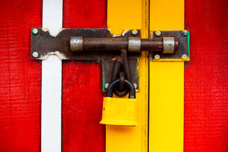 Colorful painted door with a closed lock at the small town of Salento in Colombia Standard-Bild