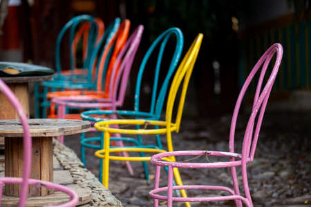 Group of colorful painted chairs at the small town of Salento in Colombia