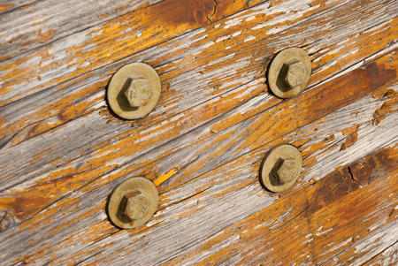 transom: Aged varnished wooden texture with bolts.