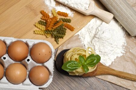 Still life with raw homemade pasta and ingredients for pasta Stock Photo