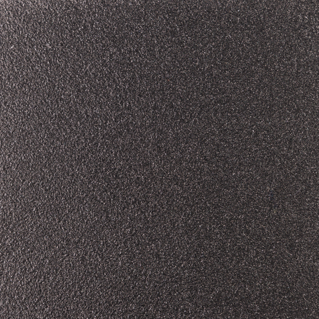 steel plate: Background texture of a shiny metal sheet with a rough stippled textured surface reflecting light. Metal texture