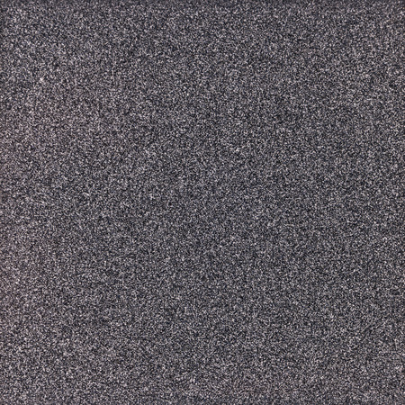 stippled: Background texture of a shiny metal sheet with a rough stippled textured surface reflecting light. Stock Photo