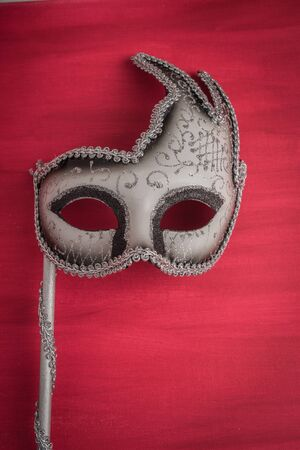 canvass: Colorful carnival mask on a red textured background. Masks with theater concept.