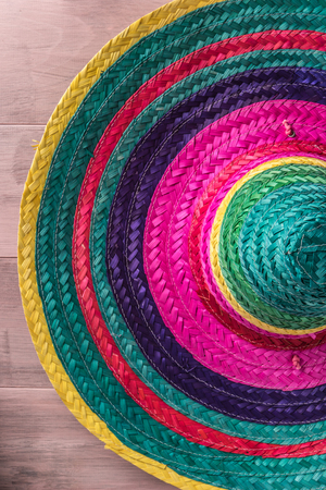 Mexican background. Sombrero on rustic wooden background. Top view with copy space