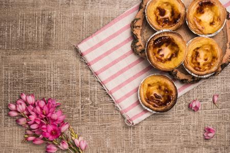 nata: Pasteis de nata, typical Portuguese egg tart pastries on a set table Stock Photo