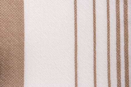 Brown and white striped towel fabric. Tablecloth texture. Cotton texture closeup, background Stock Photo
