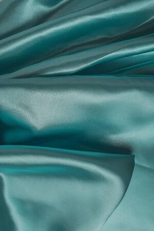 Smooth elegant emerald silk can use as wedding background. Retro style
