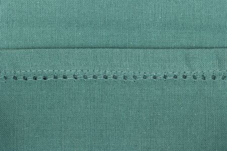 Green towel fabric. Tablecloth texture. Cotton texture closeup, background