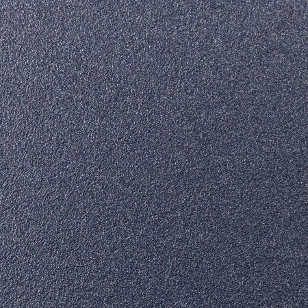 stippled: Background texture of a shiny metal sheet with a rough stippled textured surface reflecting light. Metal texture