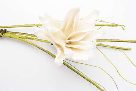 Elegant spring flower, fake gardenia on rustic wooden table. For wedding background image.