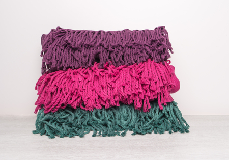 Collection of woolen soft and worm scarf on rustic wooden background. Top view with copy space