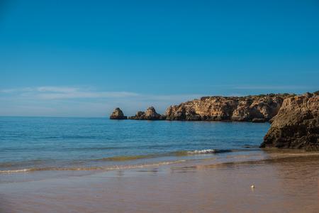 Scenic golden cliffs near Alvor, Portimao. This beach is a part of famous tourist region Algarve
