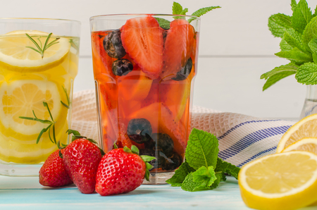 flavored: Detox fruit infused flavored water. Refreshing summer homemade cocktail Stock Photo