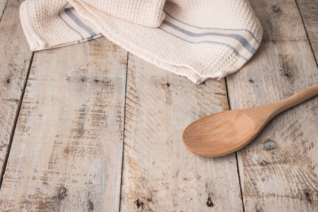Kitchen background with towel and cooking tools top view copy space. Stok Fotoğraf