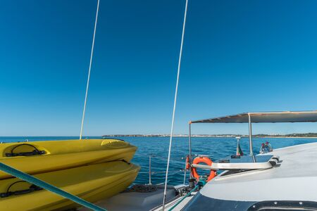 Sailing boat  and stand up paddle boards. Wide angle view in the sea Stock Photo