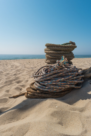 Ropes used for artisanal trawling fishing. Ropes for the Arte Xavega fishing technic on the beach of Paramos, Espinho, Portugal. Typical in this region of Portugal Stock Photo