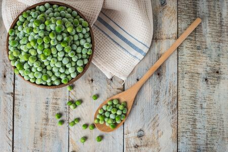 Fresh frozen peas. Vegetable food background healthy vegetarian natural meal.