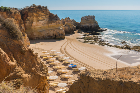 Scenic golden cliffs near Alvor, Portimao. This beach is a part of famous tourist region Algarve