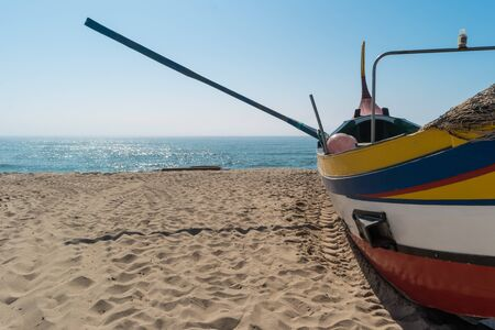 Arte Xavega typical portuguese old fishing boat on the beach in Paramos, Espinho, Portugal. Stock Photo