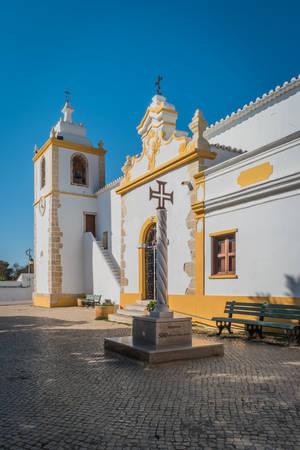 Historically church door of the Alvor Mother Church dedicated to divine Savior, Alvor, Portugal. Editorial