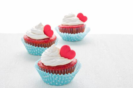 Red velvet heart cupcakes with cream cheese frosting and a red heart for Valentines Day Stock Photo
