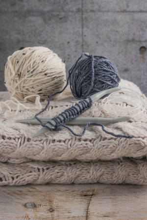 Vintage Knitting needles and yarn on wooden backgroundnatural wool knitting background.
