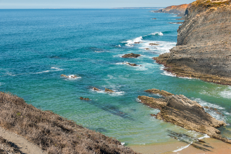Beach with rocks in Praia do Cavaleiro in Alentejo, Portugal Stock Photo