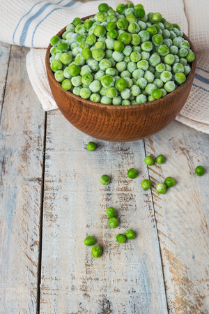 Fresh frozen peas. Vegetable food background healthy vegetarian natural meal.