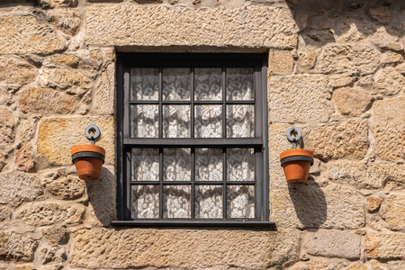 Typical window on the facade of an old house in the neighborhood of Ponte de Lima, Portugal. Stock Photo