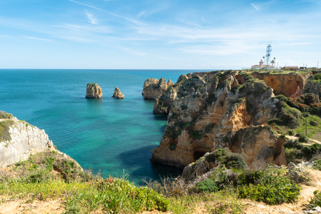 View to lighthouse on Ponta da Piedade in Lagos, Algarve, Portugal.