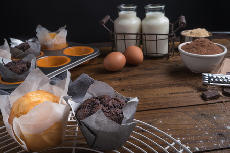 Ingredients to cooking muffins in a rustic setting on wooden table with copyspace