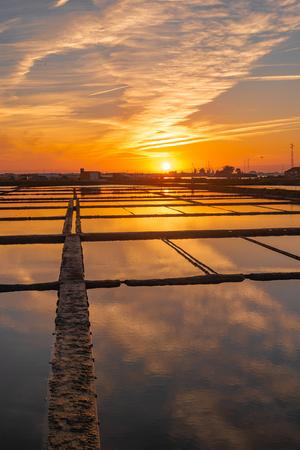 Sunset view over the salt flats of Aveiro, Portugal Banco de Imagens