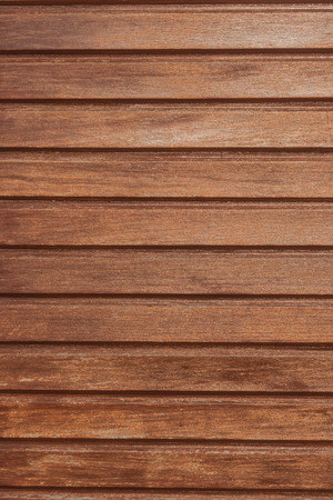 Wood grain texture background with knots and strong lines.
