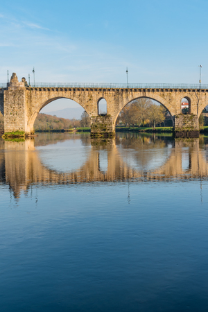 Ancient roman bridge of Ponte da Barca, ancient portuguese village in the north of Portugal. Stock Photo