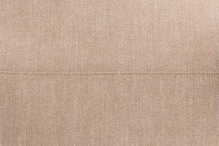 Bege towel fabric. Tablecloth texture. Cotton texture closeup, background