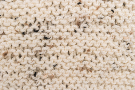 Winter Sweater Design. Bege knitting wool texture background. knitted fabric texture. Knitted jersey background with a relief pattern. Braids in knitting Stockfoto