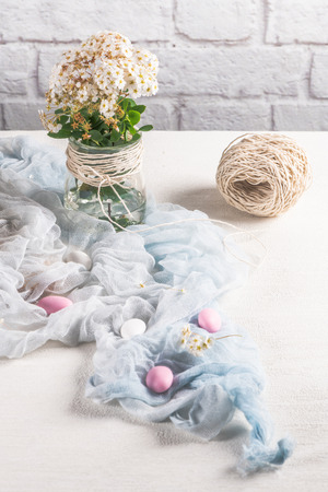 Easter background with sugared almonds, flower