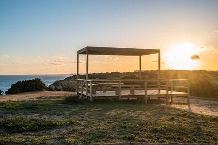 Sunset over the cliffs and beaches by Atlantic Ocean, Lagos, Algarve, Portugal. Reklamní fotografie