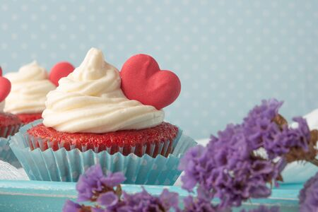 Red velvet heart cupcake with cream cheese frosting and a red heart for Valentines Day Stock Photo