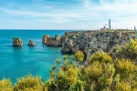 View to lighthouse on Ponta da Piedade in Lagos, Algarve, Portugal Фото со стока